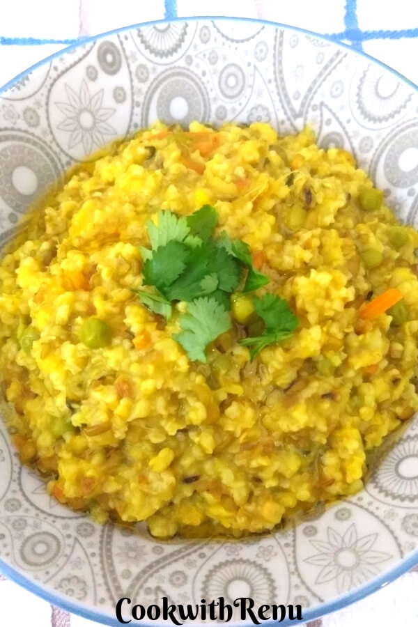 Closer look of Daliya and Split Green Moong Dal Khichdi garnished with coriander.