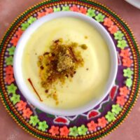 Shrikhand served in a bowl with a generous garnish of kesar and elaichi