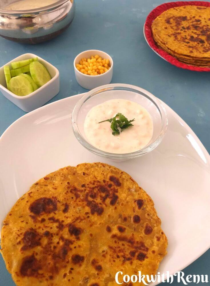 Cabbage Paratha Served with Boondi Raita