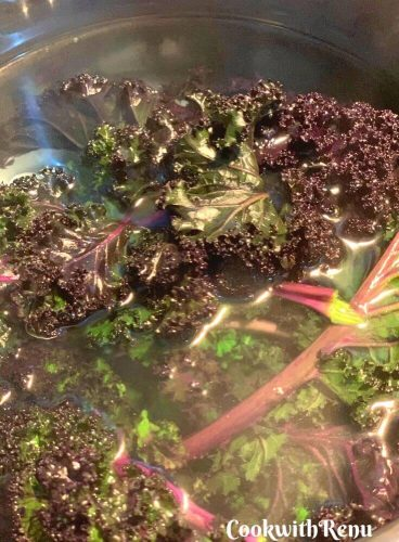 Kale dipped in cold water after being immersed in hot boiling water briefly