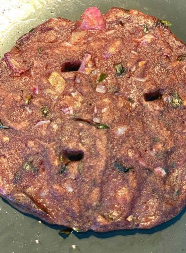 Ragi roti being cooked on a griddle/tava