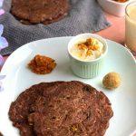 Ragi Roti Breakfast Thali served with yogurt, garlic chutney , til ladoo and chaas (Buttermilk)