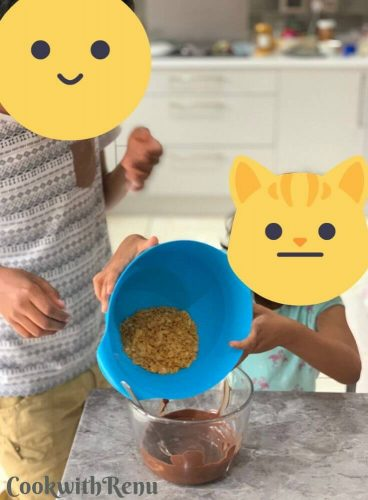 Kids adding the cornflakes into melted chocoalte