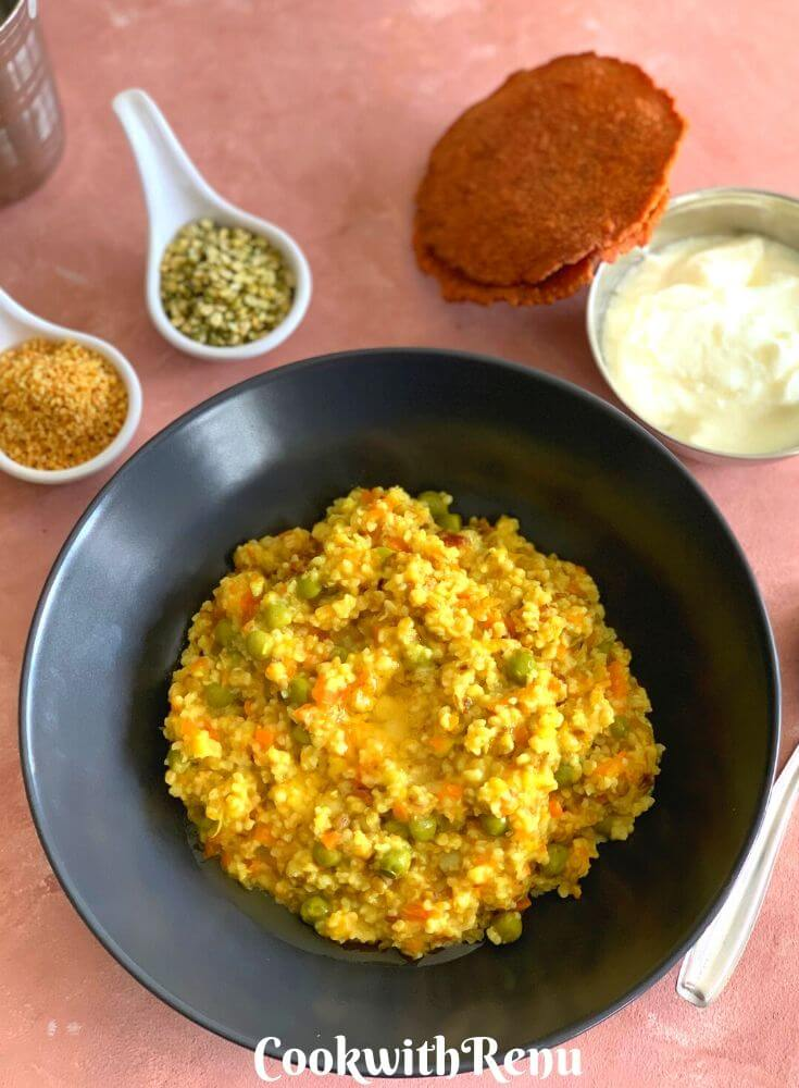 Daliya & Split Green Moong Dal Khichdi presented along with Homemade Aloo Papad and Yogurt