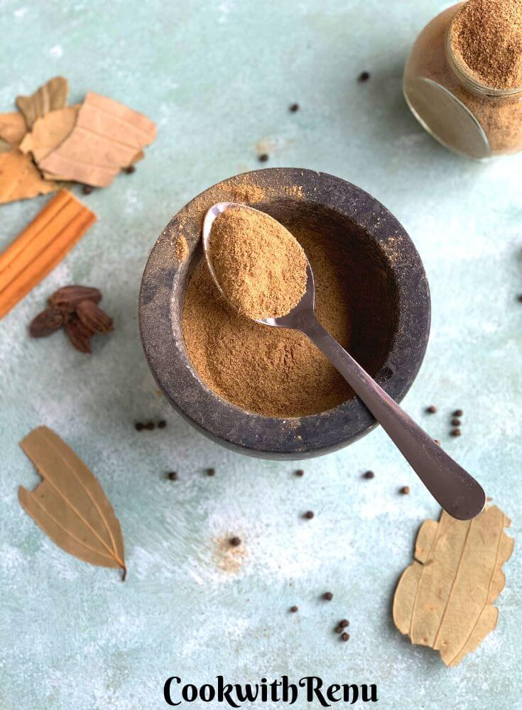 Another view of Garam Masala presented in a mortar pestle with whole spices
