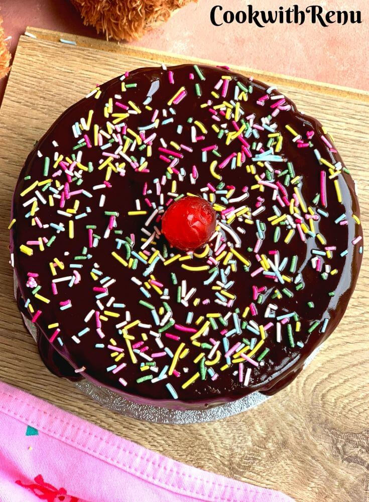 Chocolate cake with melted chocolate and colorful chocolate sprinklers