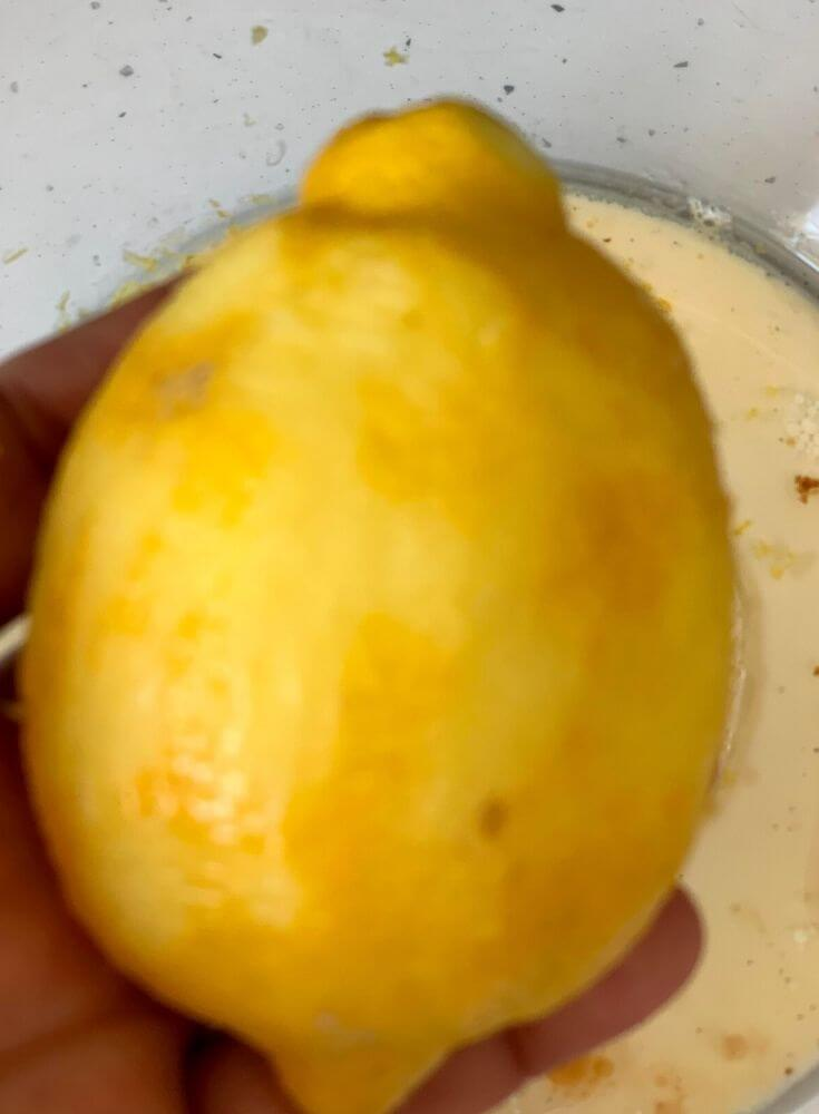 The Lemon Zest being removed, a close up look of the lemon after
