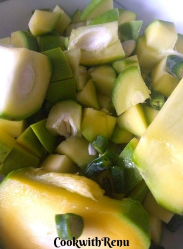 Raw mango cut into small cubes and green chilly into small pieces