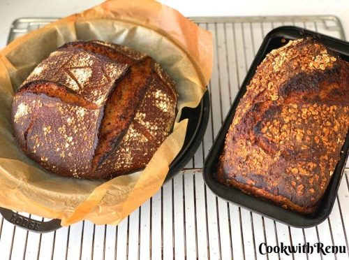2 Sourdough Breads Just out of the oven. One in Boule shape and other in loaf tin
