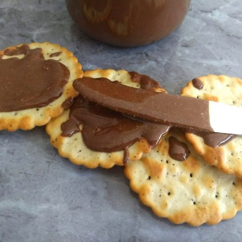 Crackers spread with Sugar-Free Hazelnut Chocolate Butter