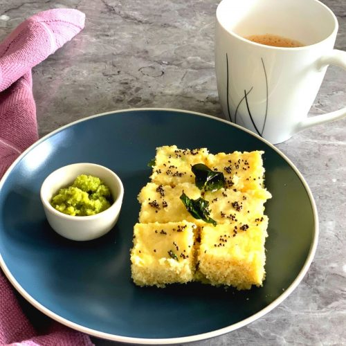 Rava Dhokla being served with Green Coriander Chutney and a cup of tea