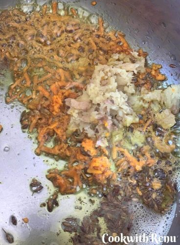 Adding of fresh grated ginger and fresh grated turmeric in the ghee and Jeera mixture