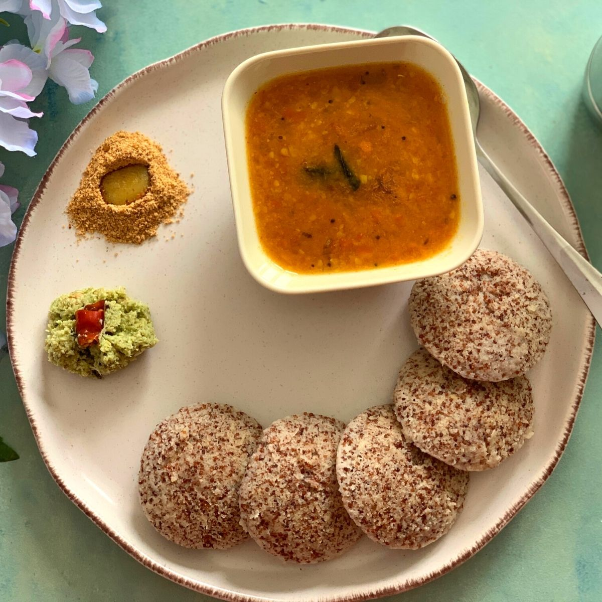 Fermented Ragi Idli are healthy, steamed vegan & gluten free breakfast/meal made using nutritious whole Ragi seeds also known as Finger Millet or Nachni.