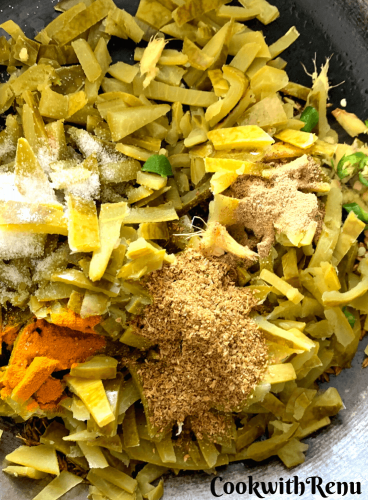 The spices, turmeric, green chillies, corainder, garam masala and salt added