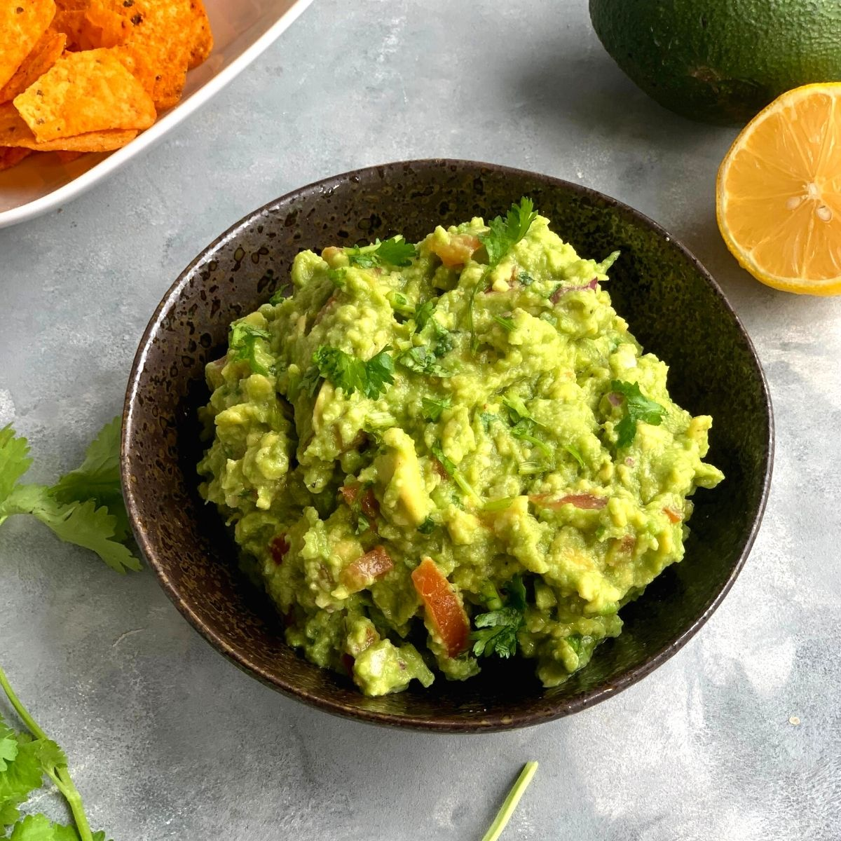 Easy Chunky Avocado Guacamole is a dip or a salad made using Avocado, Tomato, Onion and a few other ingredients. It goes well with some chips, nachos, pita bread or crackers.