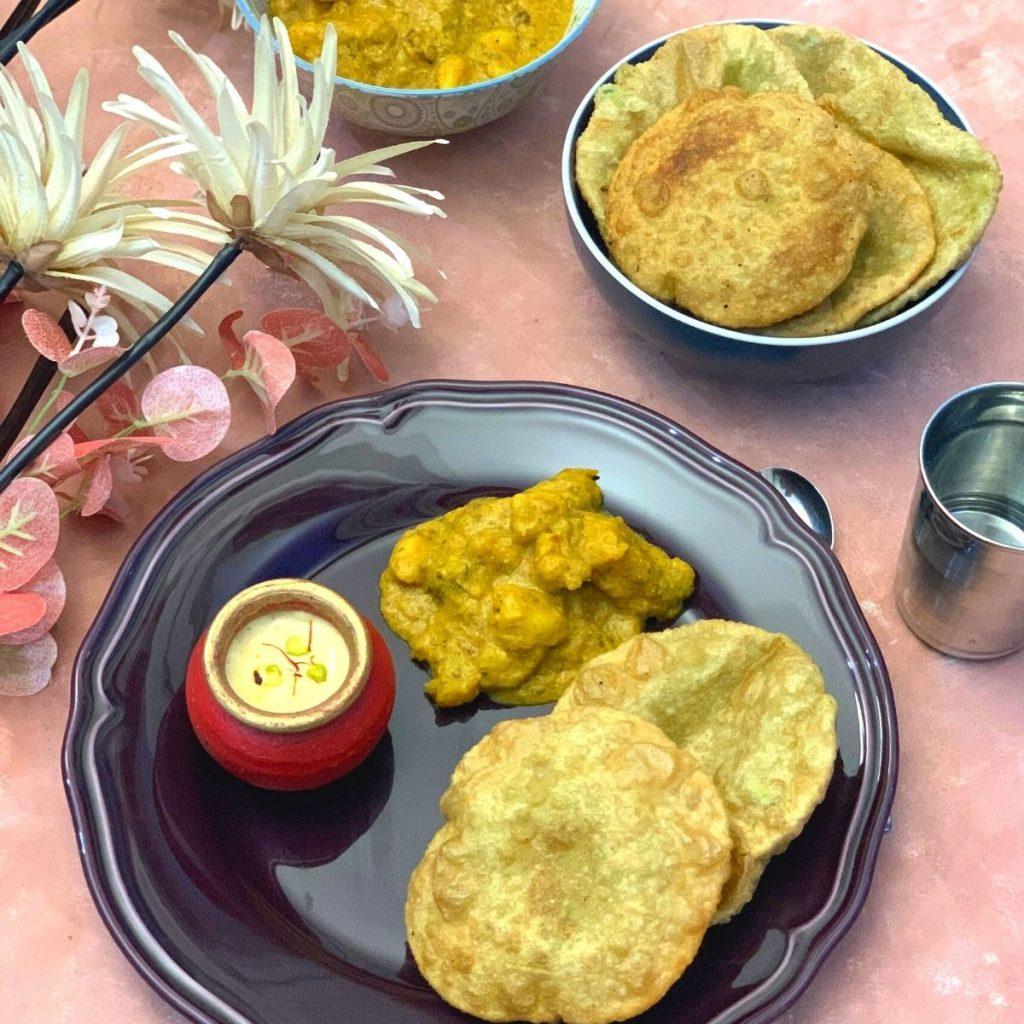 Bengali Breakfast thali is a lip-smacking vegetarian no onion no garlic thali, featuring famous Koraishutir Kochuri, Niramish Aloo Dum, and Mishti Doi.