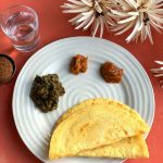 Chilka Roti is a popular breakfast recipe, made using Rice and Chana dal. A perfect balance of carbs and proteins. Served with Garlic Chutney, Tomato Chutney and Baingan Choka and Baked Bajra Tikki