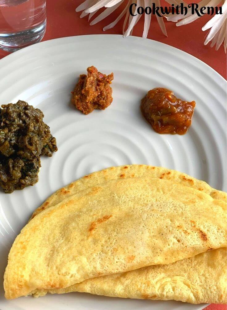 Close up look of Crispy Rice & Lentil Crepes, served with Lehsun Chutney, Tomato Chutney and Baingan Chokha