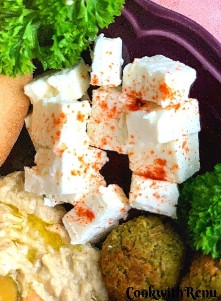 Close up look of Feta Cheese, sprinkled with smoked paprika powder