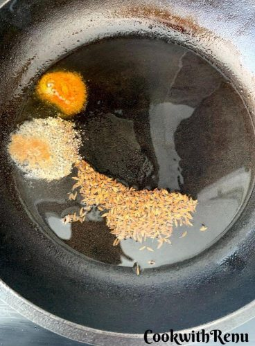 Adding of Asafoetida and turmeric powder