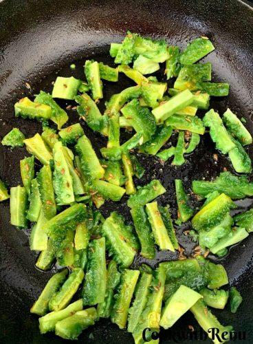 Adding of Karela into the pan