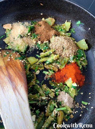 Adding of sugar, cumin powder, coriander powder, red chilly powder, amchur powder