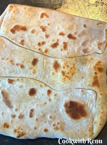 Paratha getting cooked on the underside