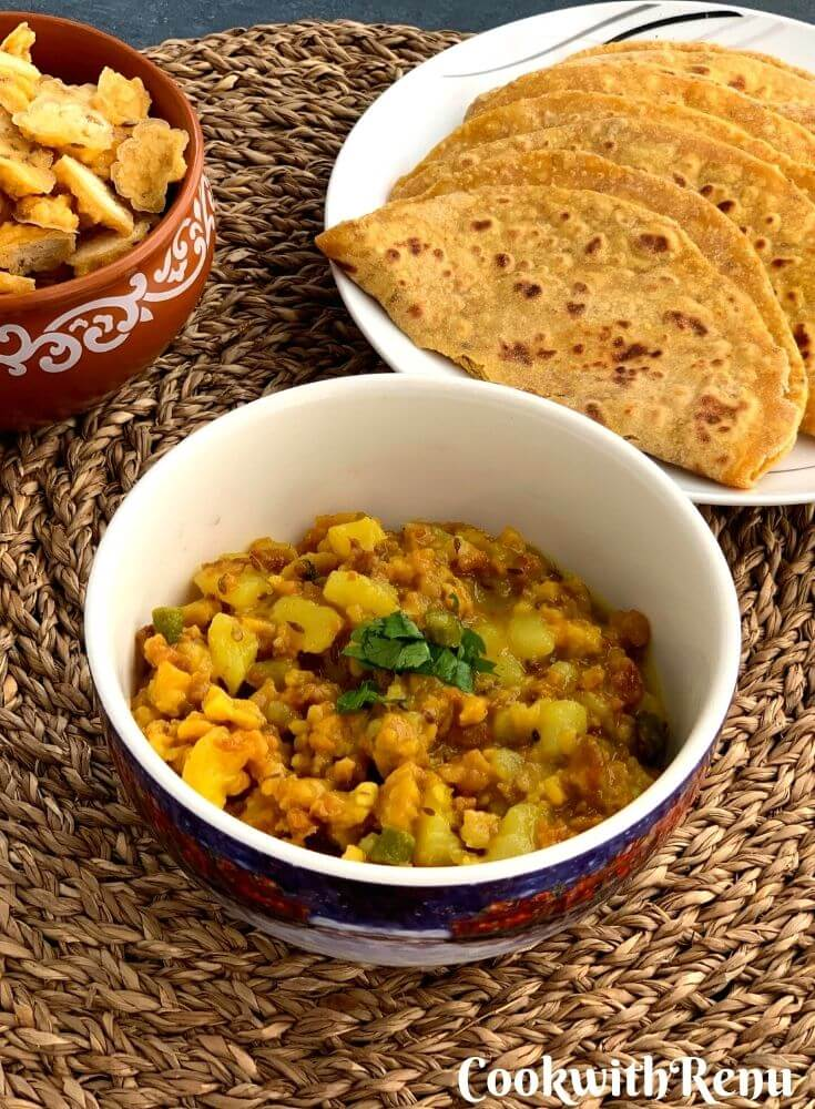 Mangodi Aloo ki Sabji is a lip-smacking sabji made using dried moong dal nuggets, potato and a few spices. It is served with missi roti.