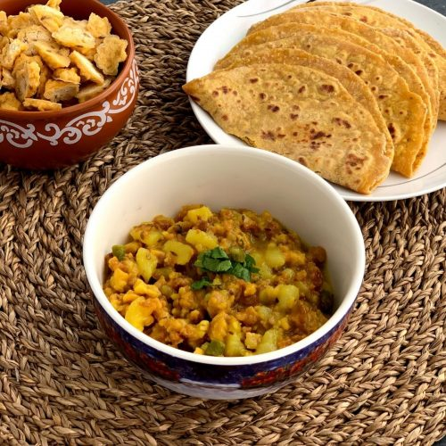 Mangodi Aloo ki Sabji is a lip-smacking sabji made using dried moong dal nuggets, potato and a few spices.