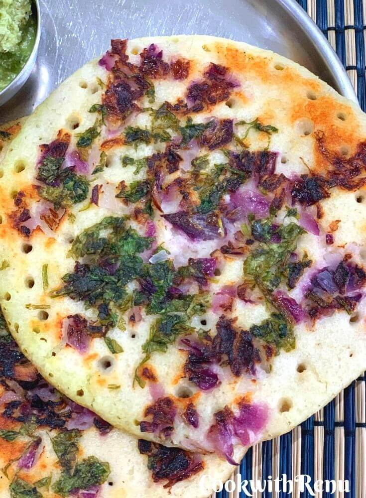 Close up look of Uttapam served in a plate, with clear distinct pores seen and soft texture and cripy edges