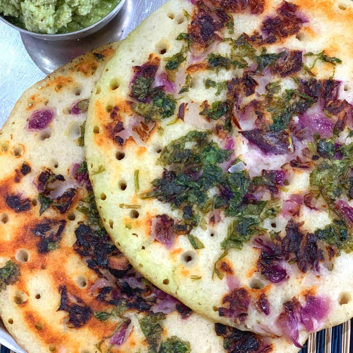 Onion Uttapam is an easy South Indian Breakfast Recipe or savoury pancakes that is made using fermented batter using Rice and Lentils.