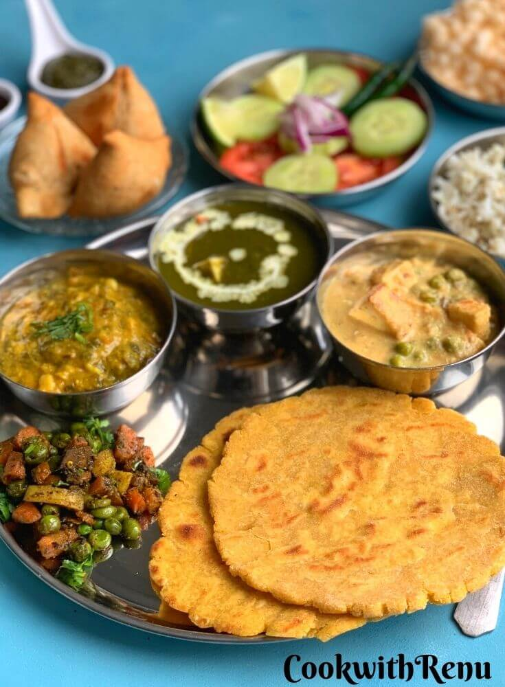 Another close up look of Punjabi Thali. Seen in the background are samosa, salad, rice and papad