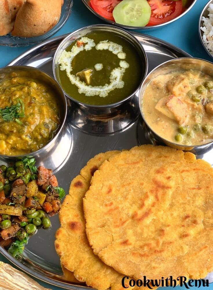 Close up look of Vegetarian Punjabi Thali, showcasing, makki di roti, and vegetables