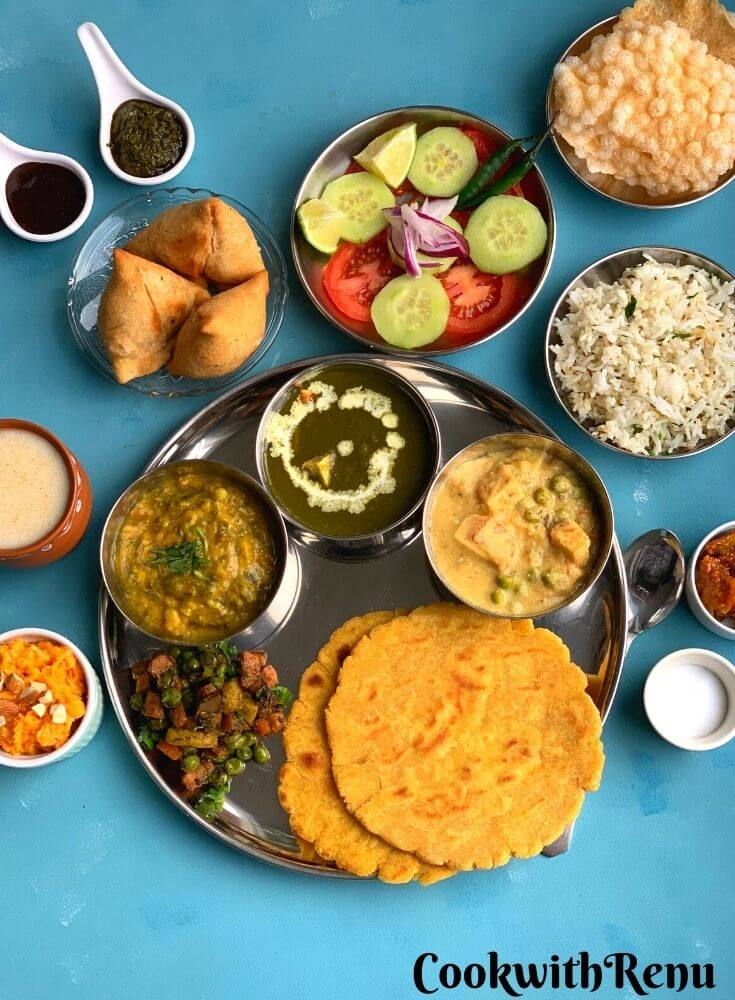 Vegetarian Punjabi thali has a range of rich buttery and paneer based dishes with gluten free makki di roti and Jeera rice.