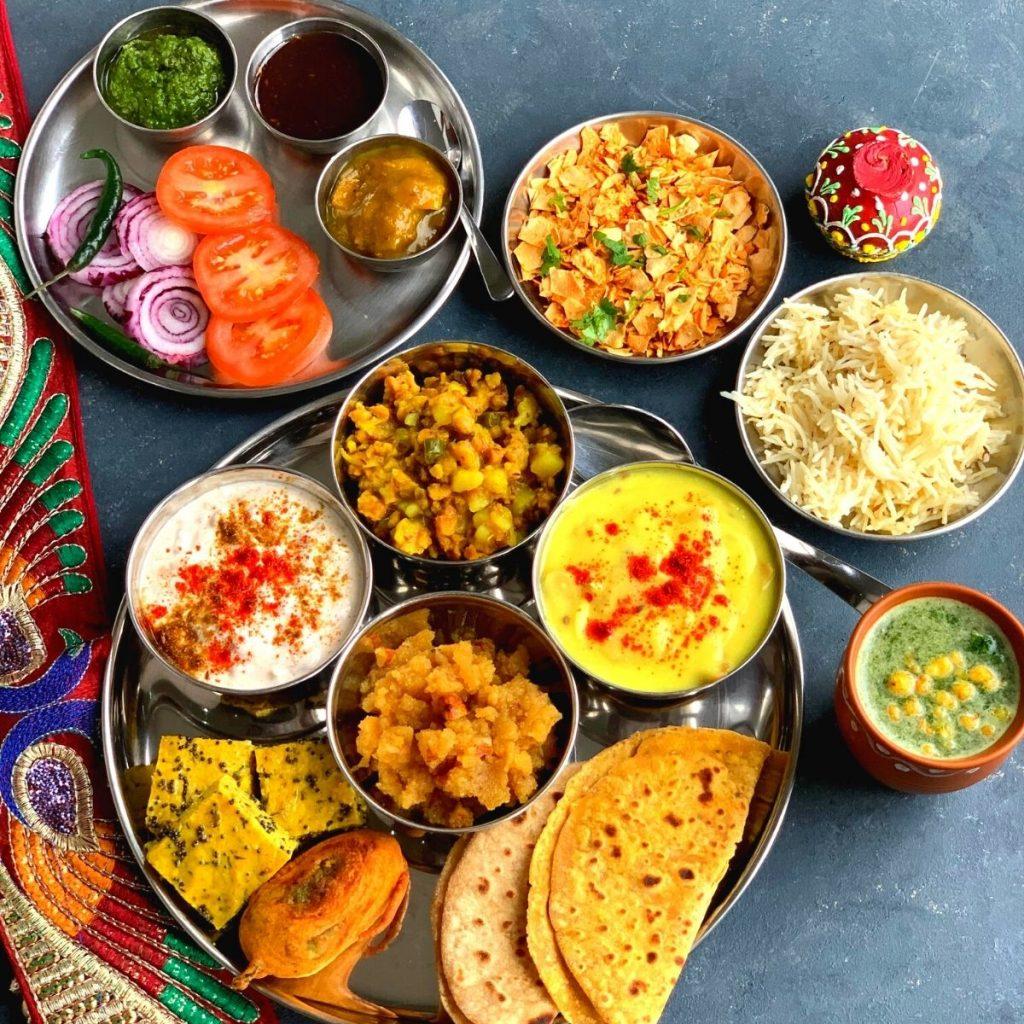 This Rajasthani Thali is a delicious thali made from pantry staple or cupboard ingredients and features Papad ki Kadhi, Mangodi ki sabji, Aam ki Launji etc.