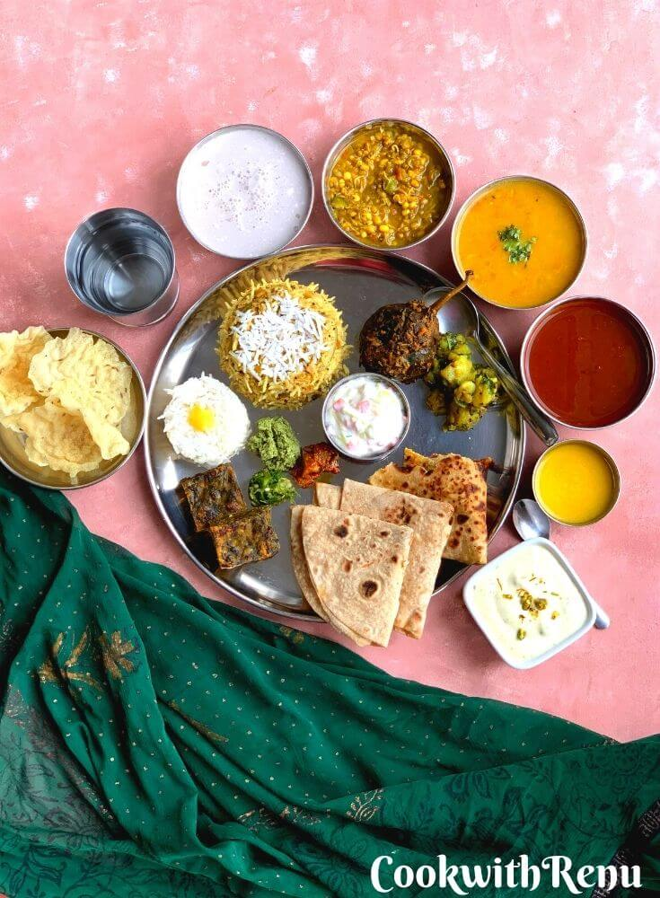 Vegetarian Maharashtrian Thali is a comforting and solu satisfying, balanced meal bursting with spicy and sweet flavours from various dishes.