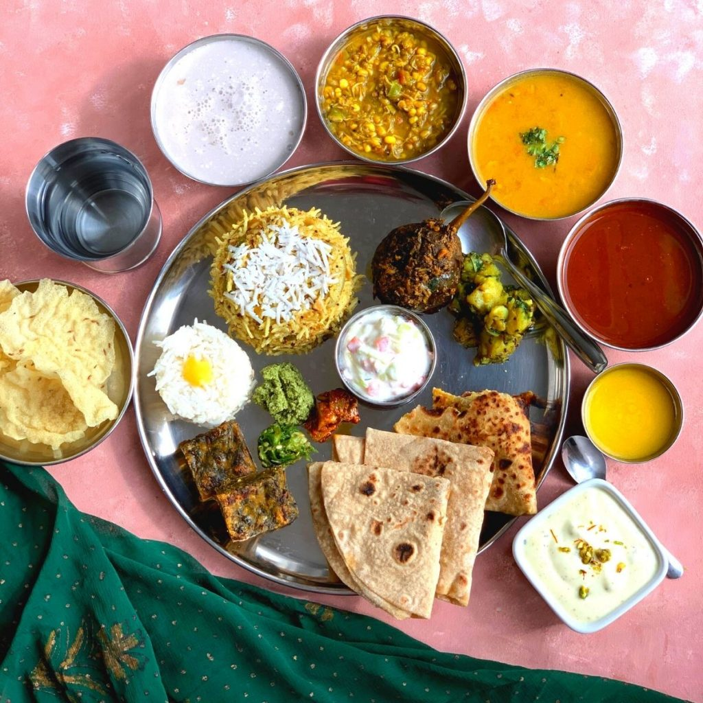 Vegetarian Maharashtrian Thali is a comforting and soul-satisfying, balanced meal bursting with spicy and sweet flavours from various dishes.