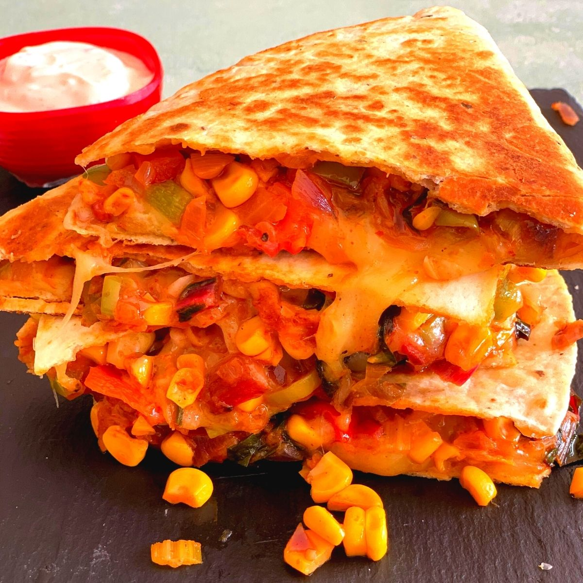 Farmer's Market Vegetarian quesadilla is an easy peasy, quick 10-minute lunch idea recipe using fresh swiss chard, peppers, and corn.