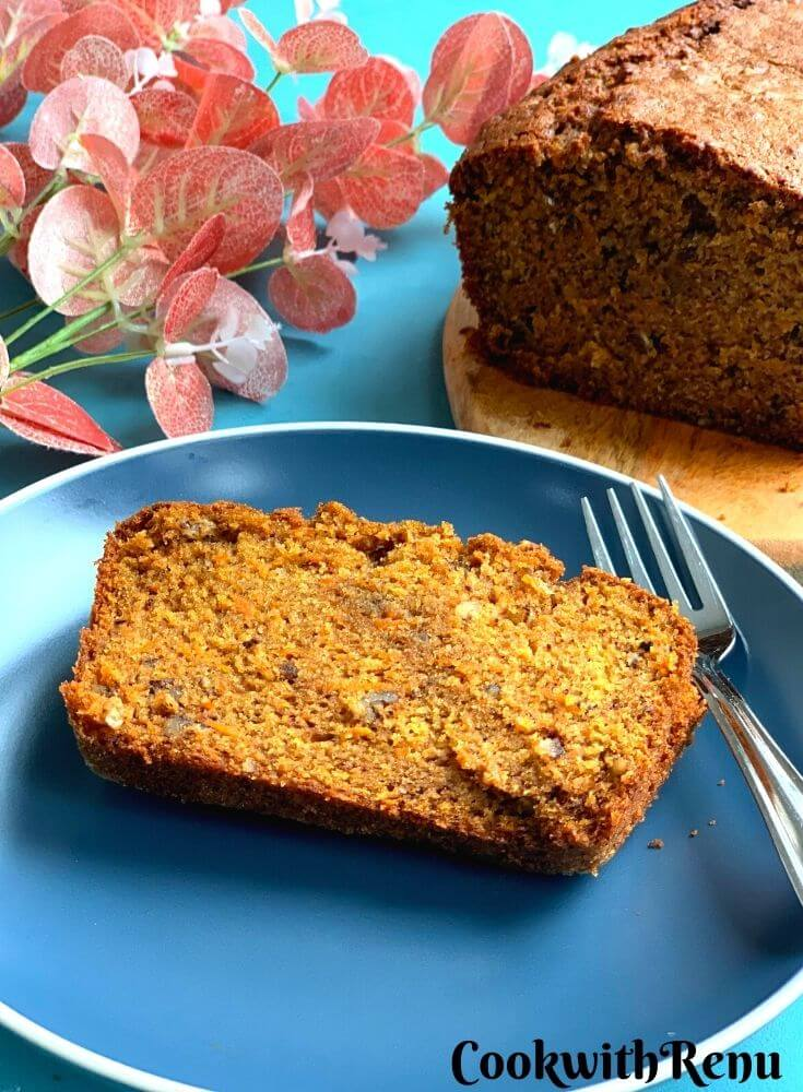 Whole Wheat Carrot Cake is a simple, quick and delicious moist cake. Grated carrots added to the batter adds to the moistness of the cake as well as give it a light texture. Walnuts or pecans are added to give it a nice crunch and cinnamon for flavour and taste. A slice of cake is served, seen in the background is the whole loaf