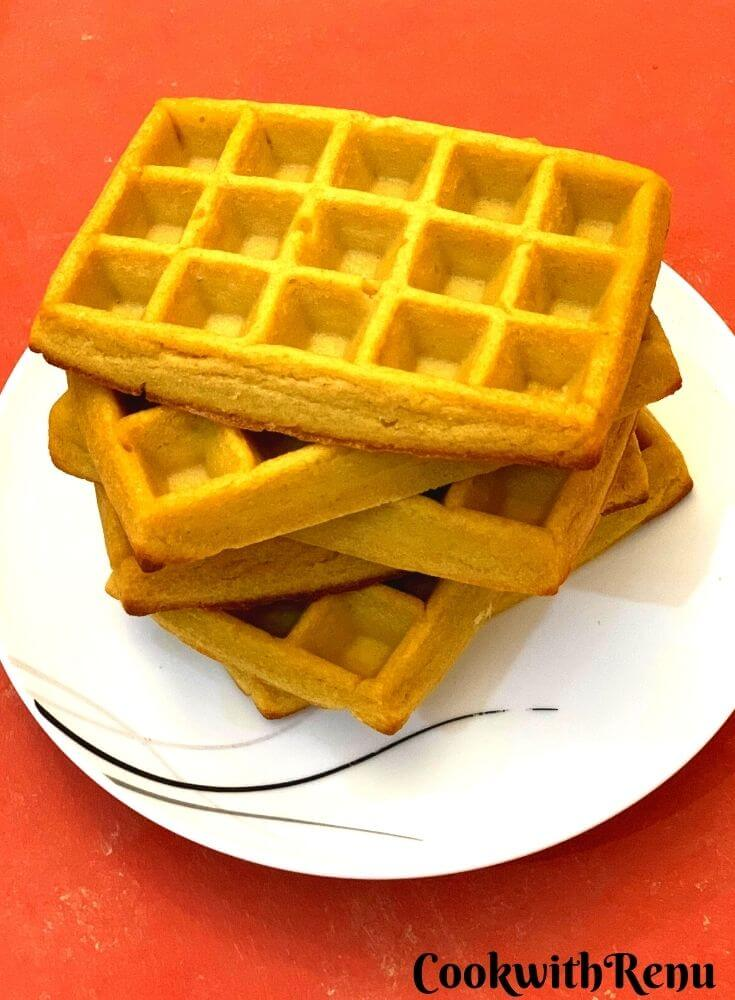 Close up look of oven baked Pumpkin Waffles, stacked one above the other