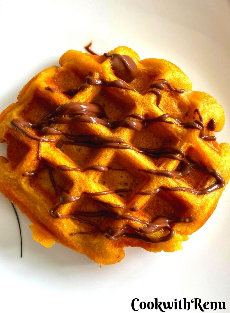 Whole Wheat Pumpkin Waffle Drizzled with some Chocolate