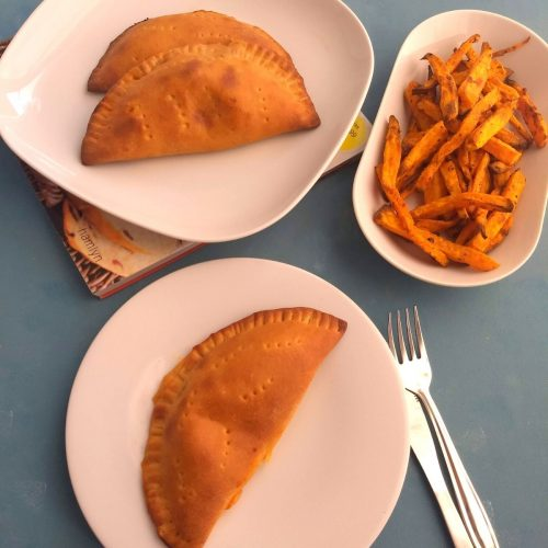 Whole wheat Vegetarian Calzones is a simple or delicious meal or a party idea for your kids, which is loaded with veggies and cheese.