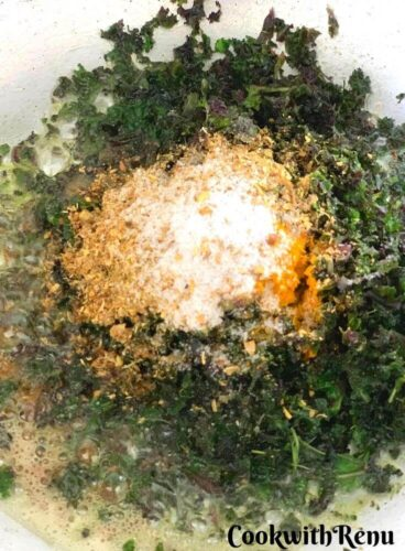 Adding of masala in kale