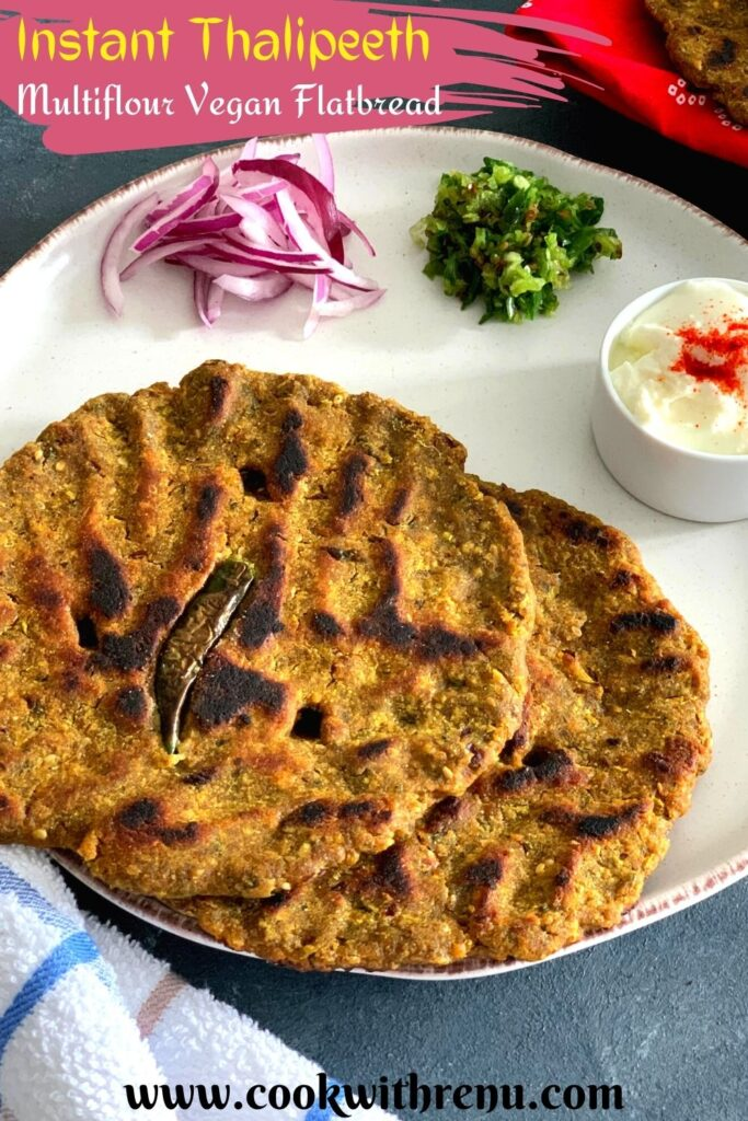 Instant Thalipeeth is a Multiflour Vegan Flatbread that is enjoyed as breakfast and is an instant version of th e typical Maharashtrian Bhajani che Thalieepth. Thalipeeth served in a white plate with yogurt, green chilly and onion along with some buttermilk