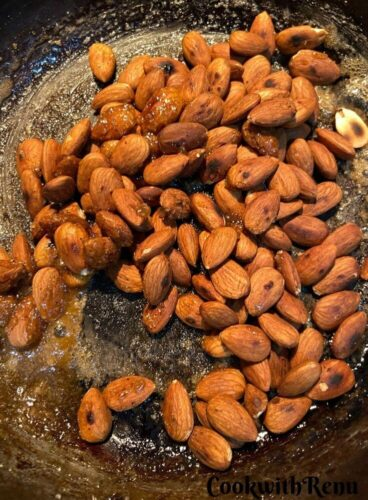 Adding of almonds in the pan