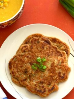 Sourdough Discard Scallion Pancakes served on a white plate, with Sweet Corn soup seen on the side along with some green scallion
