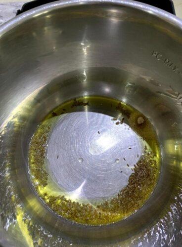 Adding of Cumin seeds and Asafotetida