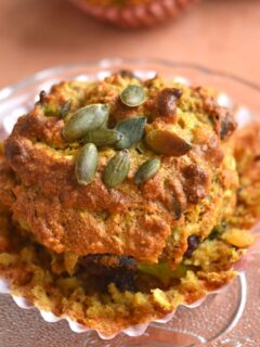 Close up look of breakfast muffins on a plate with nice texture and sunflower seeds topped on it