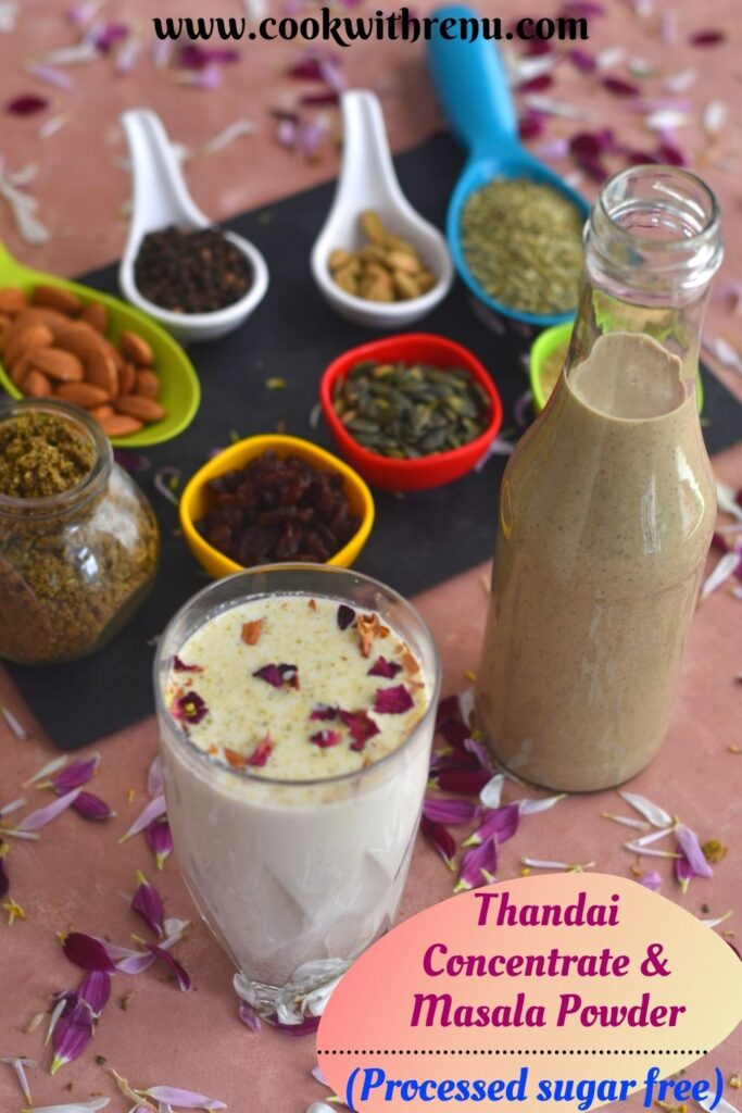 A glass of Thandai with garnish of saffron and rose petals. A bottle of Homemade Thandai concentrate, masala powder, nuts and spices seen in background