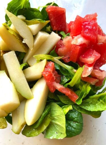 Cut pieces of Lettuce, Pear and Grapefruit